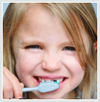 Image of child brushing teeth